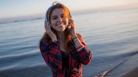 Laughing young woman enjoying the music. Stock Photo