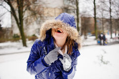 Laughing young woman after fight by snowballs. Royalty Free Stock Photography