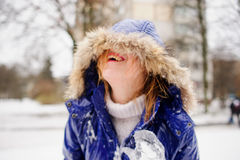 Laughing young woman after fight by snowballs. Stock Images