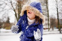Laughing young woman after fight by snowballs. Stock Photography