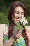 Laughing young woman with flower Stock Photo