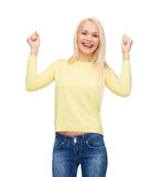Laughing young woman with hands up Stock Photography