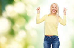 Laughing young woman with hands up Royalty Free Stock Photography