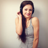 Laughing young woman in headphones listening the music Stock Photo