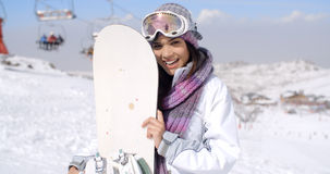 Laughing young woman with her snowboard Royalty Free Stock Photography