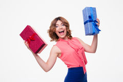 Laughing young woman holding gifts Royalty Free Stock Photo