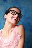 Laughing young woman in modern glasses Stock Images