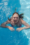 Laughing young woman in the pool, close-up portrait Stock Image