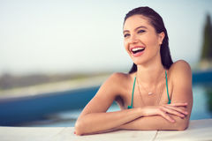 Laughing young woman in pool Royalty Free Stock Photos
