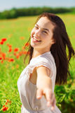 Laughing young woman on poppy field Stock Image