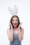 Laughing young woman in rabbit ears Royalty Free Stock Photos