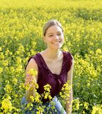 Laughing young woman in field stock photo