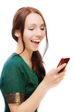 Laughing young woman reads sms. On white background Stock Photos