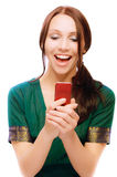 Laughing young woman reads sms. On white background Stock Photo