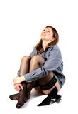 Laughing young woman in shirt and black stockings. Stock Photography