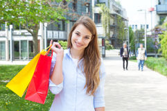 Laughing young woman with shopping bags Royalty Free Stock Photo