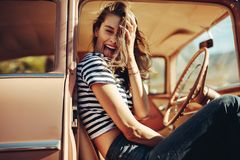 Laughing young woman sitting in the car Royalty Free Stock Photo