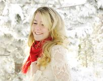 Laughing young woman in snow. Blonde laughing woman in snow Royalty Free Stock Photo