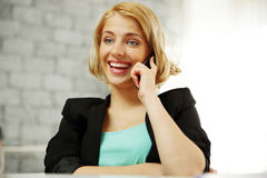 Laughing young woman talking on the office Royalty Free Stock Image