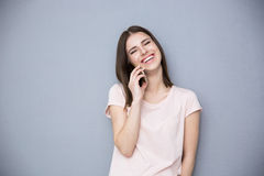 Laughing young woman talking on the phone Royalty Free Stock Photography