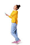 Laughing young woman walking with mobile phone Royalty Free Stock Photos
