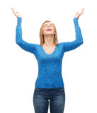 Laughing young woman waving hands Stock Photos
