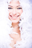 Laughing young woman in white downy boa Stock Photo