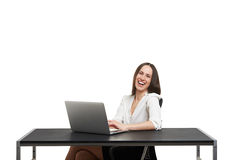 Laughing young woman working Royalty Free Stock Images