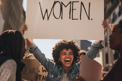 Female activist protesting for women empowerment Stock Photos