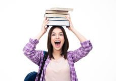 Laughing young wowan with books on head Stock Photo