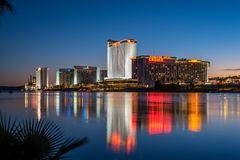 Laughlin Waterfront at Dusk. The Colorado River flows past the hotels and casinos of Laughlin, Nevada at dusk stock images