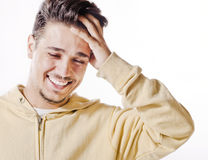 Laughs of latin man in studio shot Royalty Free Stock Image