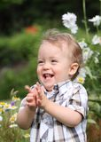 Laught. Baby clapping and laughing in nature Stock Image