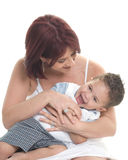 Laughter. Mother tickling her young son Royalty Free Stock Photos