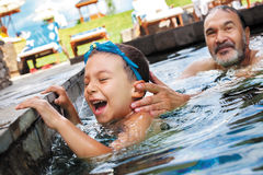 Laughter boy grandfather pool Stock Photography