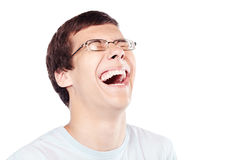 Laughter closeup. Close up of young hispanic man wearing glasses laughing out loud with closed eyes  over white background - laughter is best medicine concept Royalty Free Stock Photos