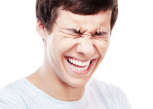 Laughter closeup. Face close up of young hispanic man laughing out loud with closed eyes - laughter is best medicine concept Stock Photography