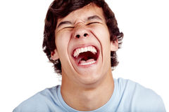 Laughter closeup. Laughing out loud young man face closeup - laughter concept royalty free stock photo