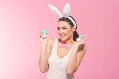 Laughter  woman-bunny with easter eggs Stock Image