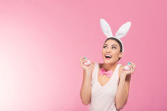 Laughter  woman - bunny looking on big copy space Royalty Free Stock Image