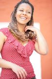 Laughter woman in red polka dress Stock Image