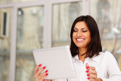 Laughting businesswoman holding tablet computer Stock Images