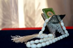 Laukh, rosary and book Stock Image