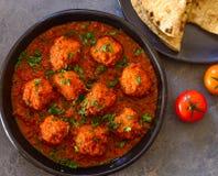 Vegan meatballs curry served with flatbread. Lauki kofta vegan stuffed meatballs with chapati royalty free stock image