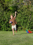 Launch. Boy running with a kite attempting to take flight Stock Image