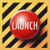 Launch button. Red button with white launch letters on diagonal orange and black background Royalty Free Stock Photography