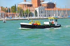 A launch on a canal in Venice near San Giorgio Island Stock Photos