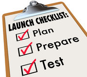 Launch Checklist Plan Prepare Test New Product Business. Launch Checklist of a clipboard with check marks in boxes to illustrate becoming ready for a start or Stock Photo