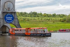 Launch leaves the Falkirk Wheel, rotating boat lift in Scotland, Stock Image