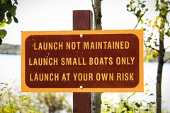 A launch not maintained use at own risk sign.  stock photography